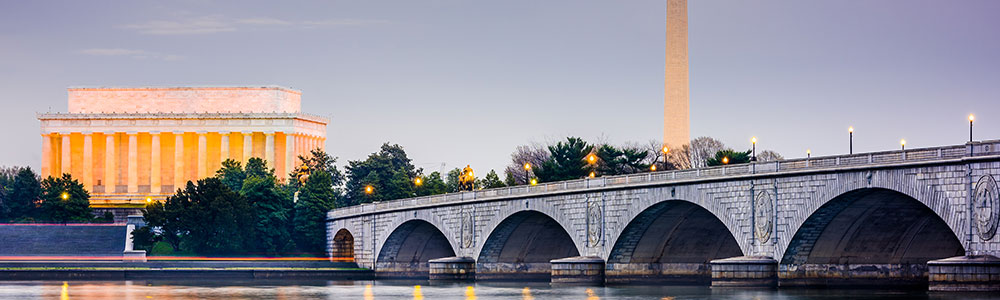 The Memorial Bridge, Lincoln Memorial, and Washington Monument shot from the other side of the Potomac River